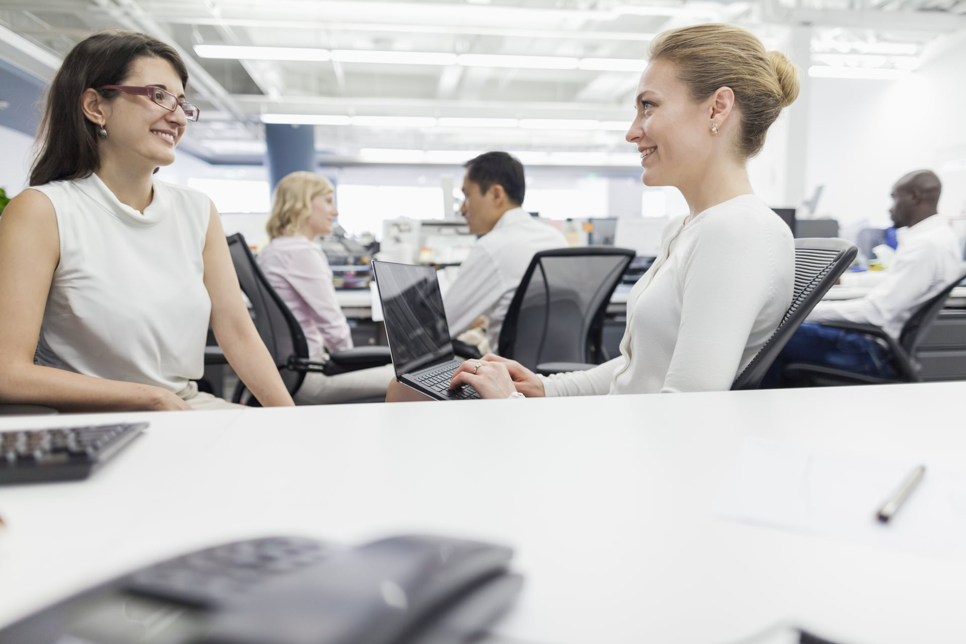 women-talking-together-in-office